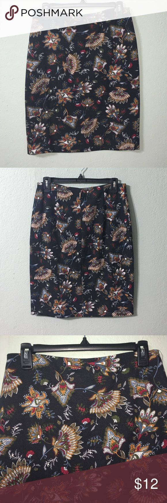 Black multi color Grace Elements skirt. Black multi color skirt with elastic waistband and zipper stretch material. Skirt is a size small but will fit a size medium/large if you like the skirt with a tighter fit. Grace Elements Skirts Midi