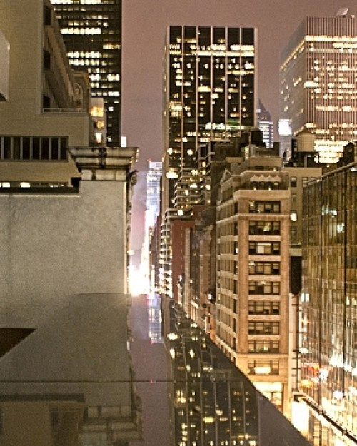 The Gotham Hotel (foreground); looking west on 46th Street from between Fifth and Madison