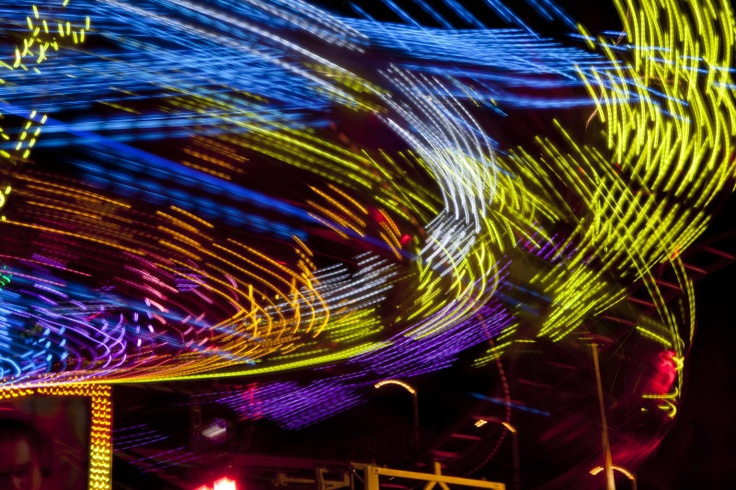 Multi-colored light trails formed by a ride at the Florida State Fair in Tampa.