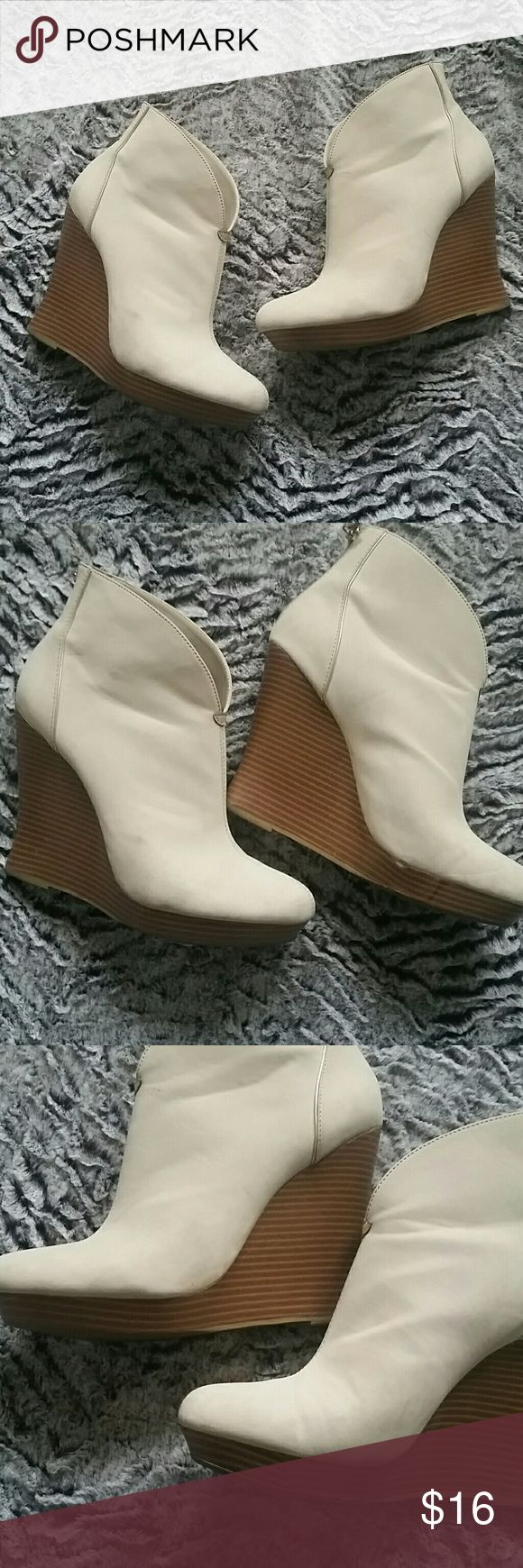Jennifer Lopez wedges Jennifer Lopez cream colored wedges.  A little dirty a few marks on them and a small scrape that is shown in the pictures.  But still in good condition.  Definitely a lot of life left in them.  Heel height is 4 inches with a 3/4 inch platform. Jennifer Lopez Shoes Wedges