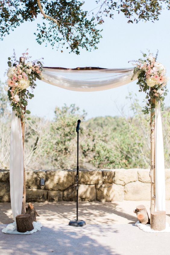 flower accented wedding arch / http://www.deerpearlflowers.com/wedding-ceremony-arches-and-altars/