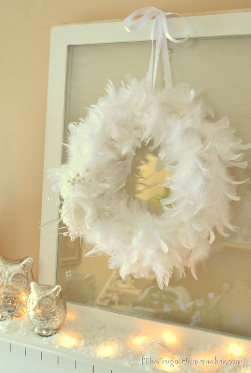 Winter White Feather Wreath, OMG a way to have lots of contained feathers at the wedding!!!!!