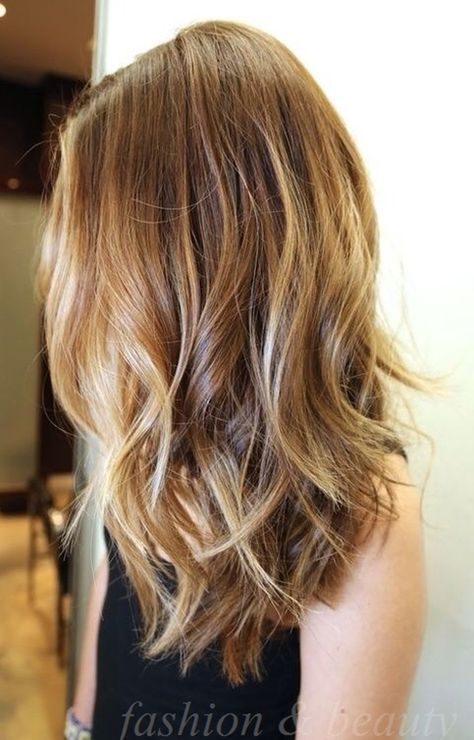 Long angled bob with layers. Love the coloring