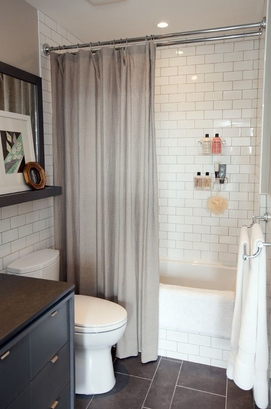subway tile and slate again - nice! Love the contrast of the soft drapey gray shower curtain anbd the angles of the tile