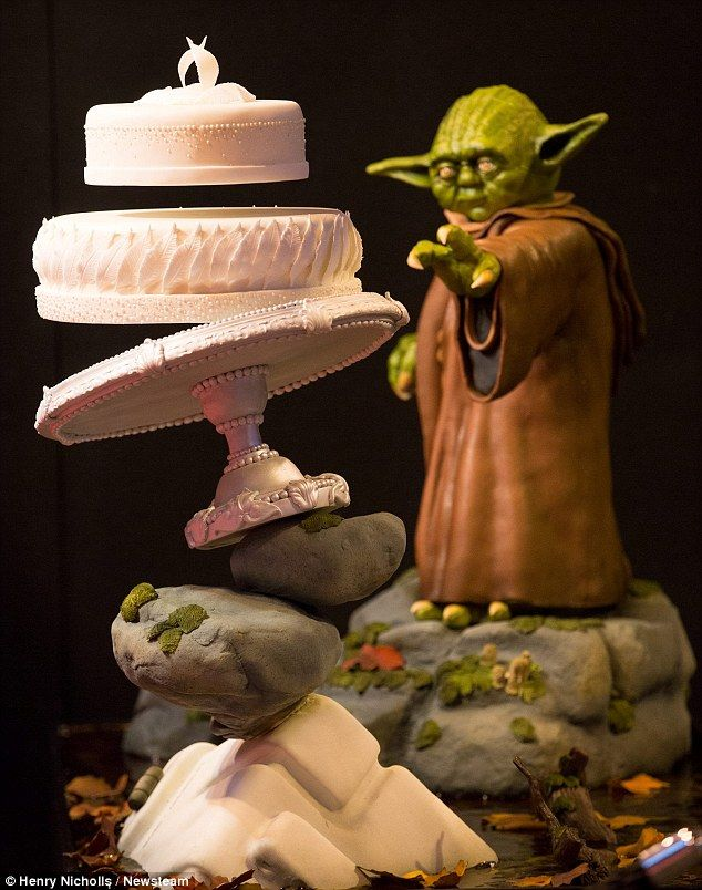 The 4ft (1.2m) tall gravity-defying Star Wars wedding cake which features a top tier which looks like it is floating in mid-air is just one of the many impressive desserts on display at Cake International in Birmingham