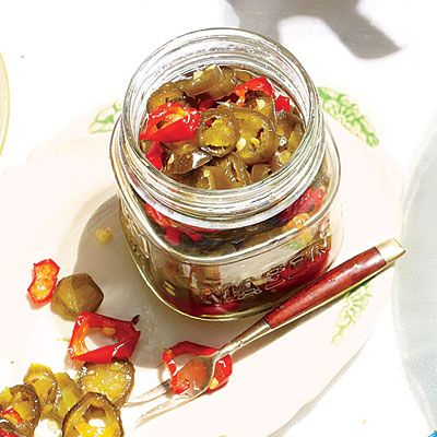 Candied Jalapeños | This is our new go-to summer condiment. Chill at least 48 hours ahead so the jalapeños have time to take on a fiery-sweet crunch. | #Recipes | SouthernLiving.com