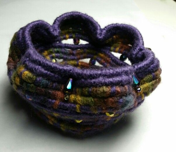 Coiled and beaded basket.