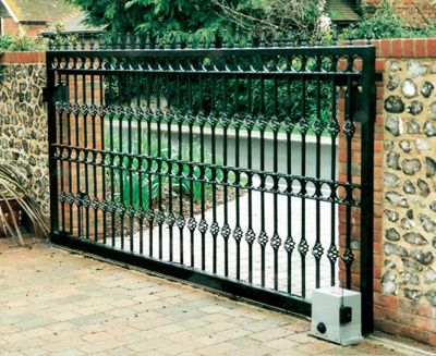 Outside Roof Patio Idea: Wrought iron driveway gate