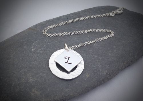 A cute hammered necklace with a monogram initial.