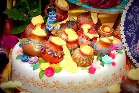 Krishna cake snuggled down among the butter pots