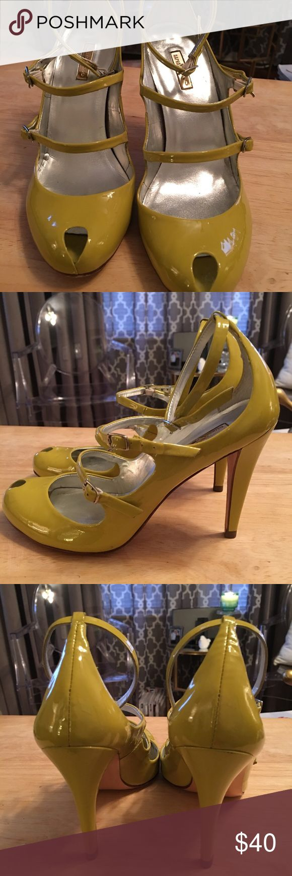 Report Signature strappy heels Lime green strappy peep toe heels. They are patent leather and have three straps with buckles. They are in a great used condition. Report Signature Shoes Heels