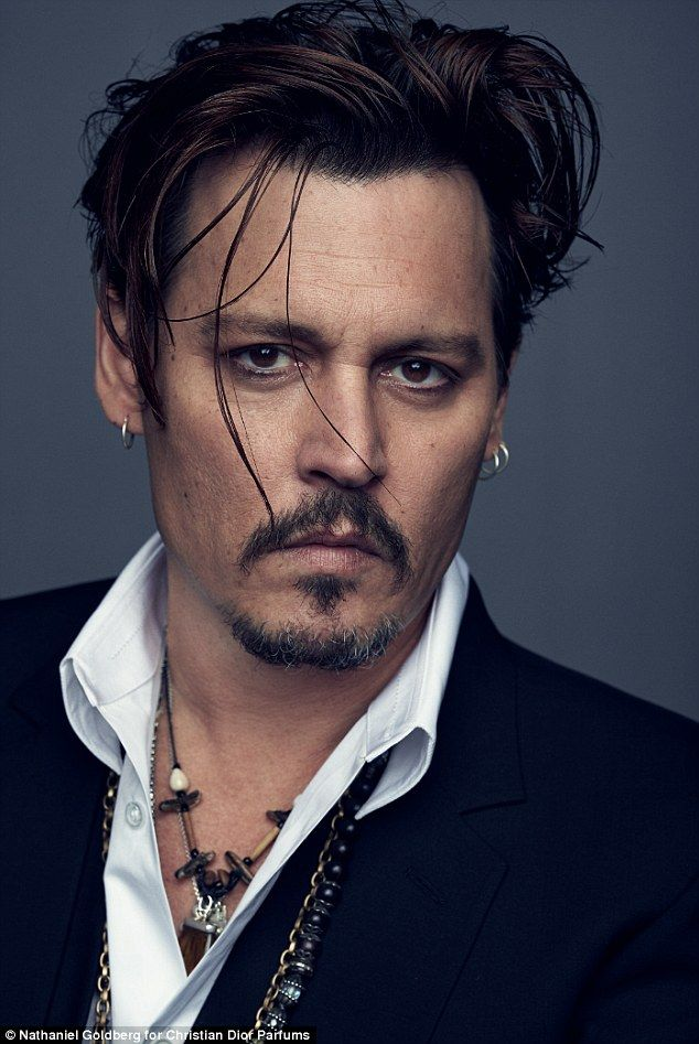 Johnny Depp has ditched the braids and bandanna as he's unveiled as the face of Dior's new fragrance