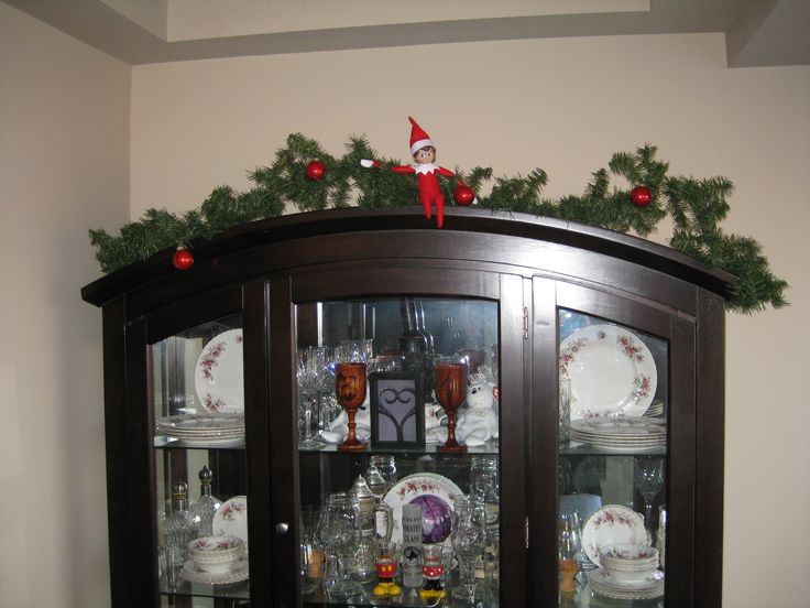 December 17, 2014 ~ Sparky sitting on our china cabinet.