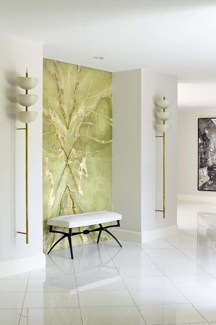 fabulous onyx wall and sconces at the updated miami vice home, designed by brown davis interiors