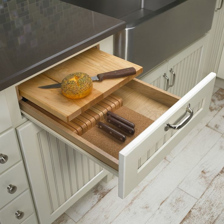 I want this! A cutting board and knife storage built into one drawer.