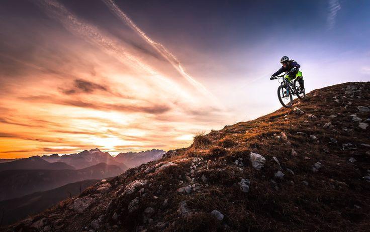 Sunset Mountain Bike Photography. Riding mountain bikes down hills.