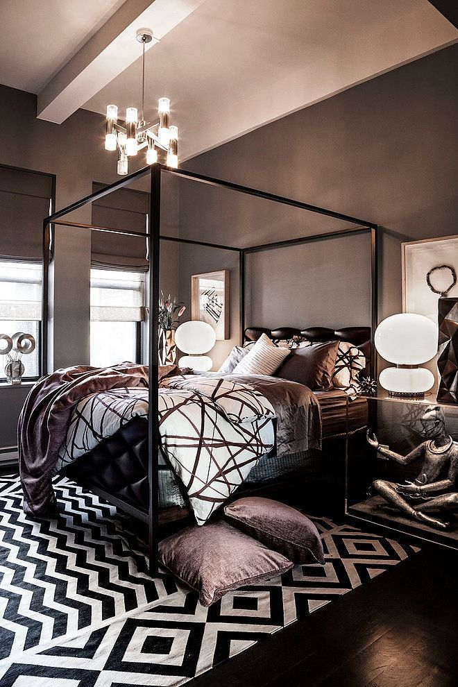 The geometric patterns and black, white, and grey palette give this room a very modern but warm feel.
