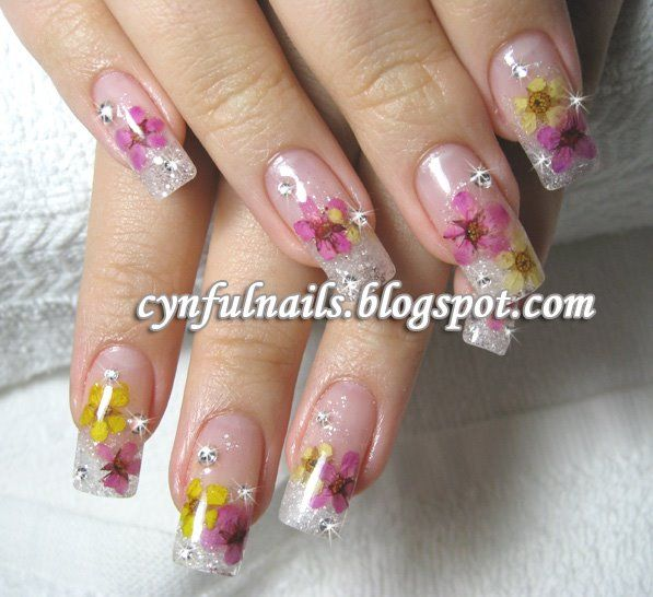 Dried flowers nail art...  I wonder if this works with real dried flowers?