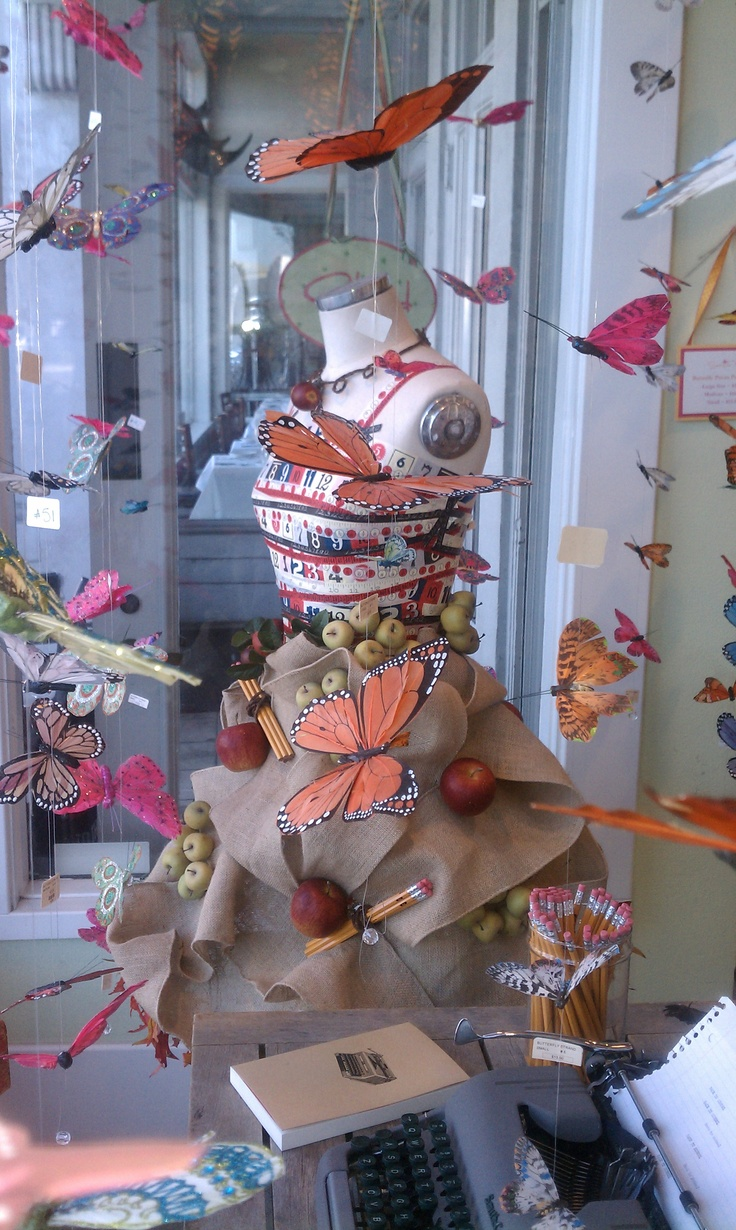 Window display from card shop on Coronado Island. Hanging butterflies!