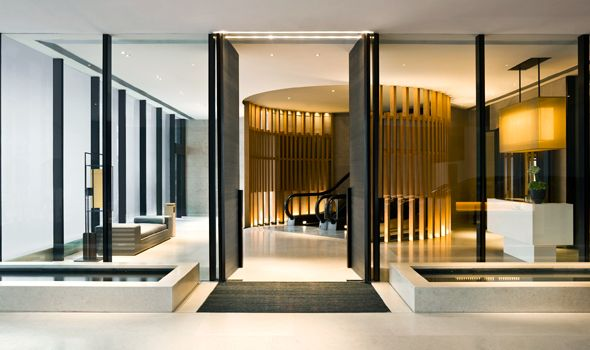 """Hong Kong: Nurtured by neon gallery  The Upper House  Designed by Andre Fu, this exercise in contemporary Asian luxury sits atop the Marriott with a discrete entrance through a curved """"stone curtain"""" on the atrium level of Pacific Place."""