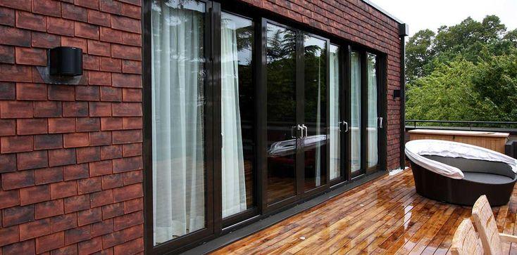 Aluminium sliding doors leading onto the terrace, by IQ Glass