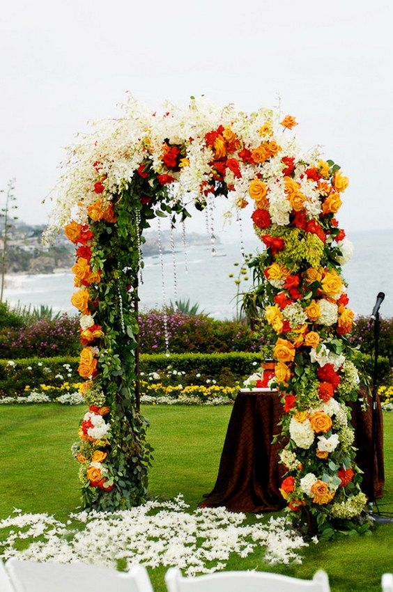 wedding arch with read orange and white florals and crystal details / http://www.himisspuff.com/fall-wedding-arch-and-altar-ideas/8/
