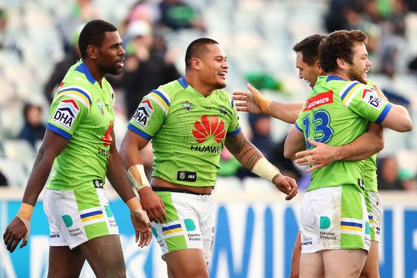 Joseph Leilua of the Raiders celebrates with team mates after scoring a try during the round 20 NRL match between the Canberra Raiders and the New Zealand Warriors at GIO Stadium on July 23, 2016 in Canberra, Australia.