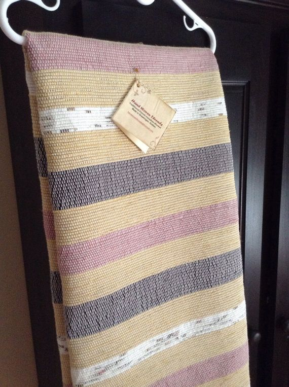 This beautiful new handwoven blanket measures 58 wide by 102 long. Dusty rose, black and patterned white stripes alternate on a soft mustard background colour. Perfect for a twin-size bed or an accent throw on a larger bed or couch. The cotton blend fabrics woven throughout the blanket add warmth and comfort for the cold winter nights. Fabricated on a traditional floor loom, it is unique and of artisan quality. Gentle machine washing and hanging it to dry will keep it looking its best for…