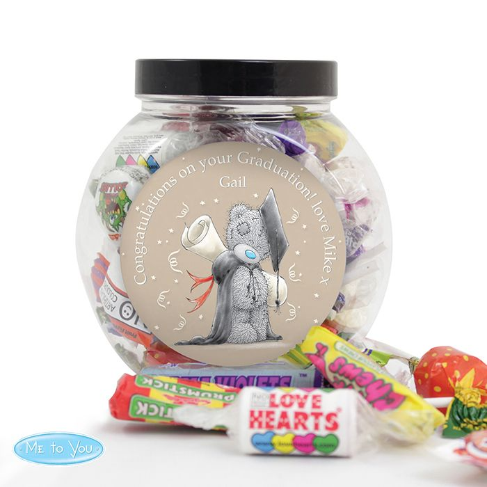 Personalise this 'Me To You' graduation sweets jar with a name of up to 12 characters long and a message around the lable of up to 45 characters.  Sweet Jars and Content weigh a total of 250g  Sweet Jar is plastic with black plastic screw top.  Sweets are an assortment of Swizzels Matlow sweets.  May Contain Nuts.  Lollipops are a potential choking hazard.  Not suitable for children under 36 months.  NOTE: Due to the font type used please refrain from using all capitals in your personalised…