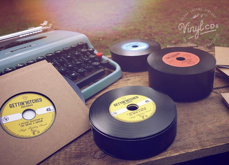 We have custom-designed these to emulate the classic vinyl record labels of the 50's, 60's & 70's.  This particular style comes with a classic vintage-look golden yellow label as pictured.  Each disc comes with it's own vinyl record-style cardboard sleeve (in your choice of color). http://www.vintagevinylcds.com/wedding-favors-bomboniere/vintage-wedding-favor-vinyl-cd-yellow-gold