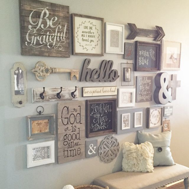 Entry Way Gallery Wall - A work in progress but I love each piece and the story behind them all. DIY Gallery Walls.
