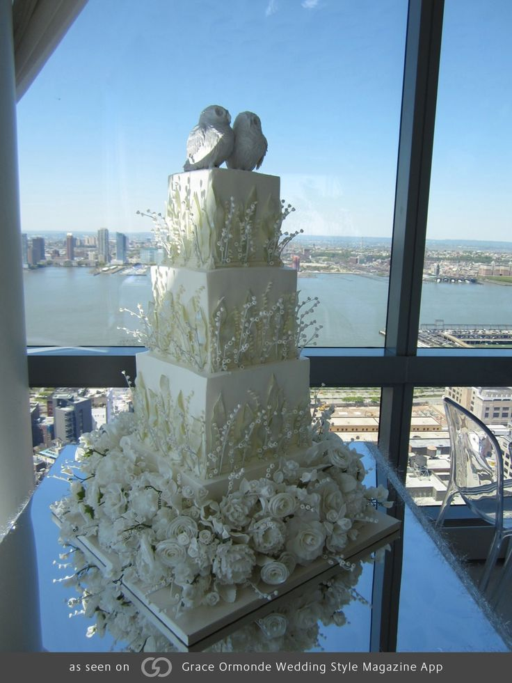 Four-tiered snow owl cake. @grace_ormande @wedding_style
