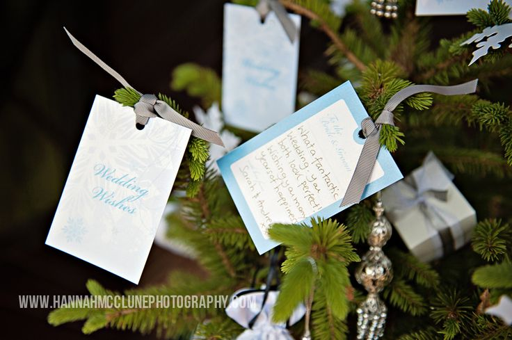 Winter wonderland, wedding wishes tree cards. An unique alternative to a guest book. These cute cards have our snowflake design on the front then space for friends and family to write a special message on the back.  Each come compete with matching beautifully tied ribbon, so they can be hung on the Christmas tree once guests have written their message.  A lovely keepsake for the bride and groom after their wedding, by www.fuschiadesigns.co.uk.