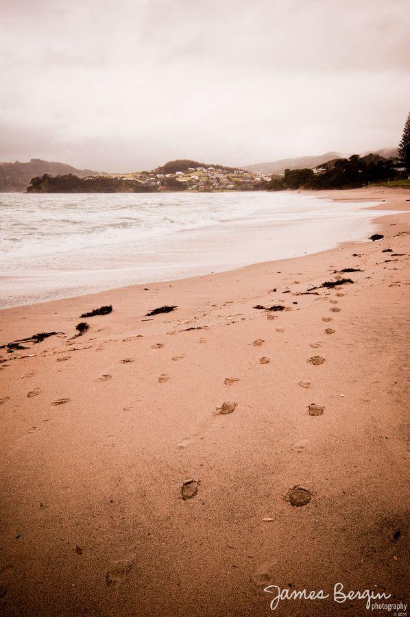 Foot steps on Waipu Cove beach