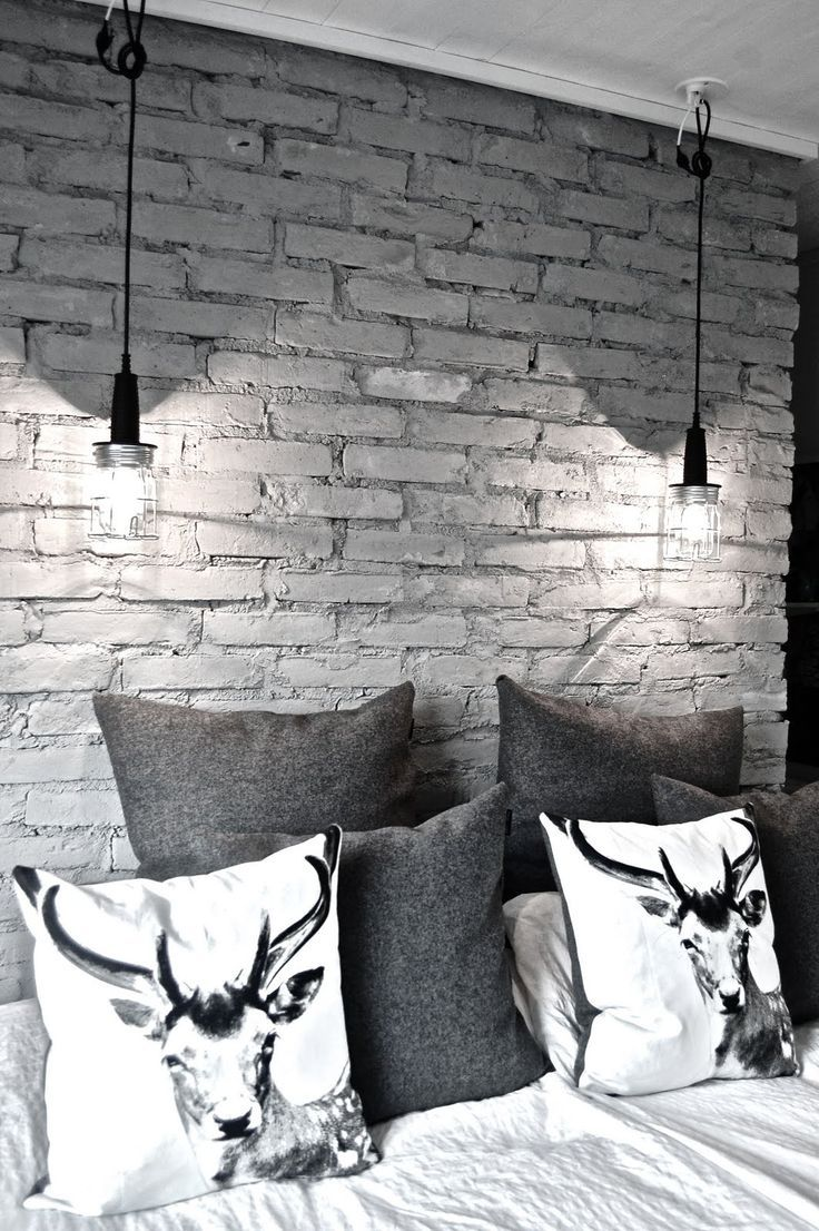 16 Beautiful Exposed Brick Wall Bedroom Ideas : Stylish Exposed Brick Wall Bedroom Design with Animal Print Pillows and Two Hanging Lamps al...