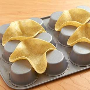 taco bowls- heat tortillas until warm, then spray with cooking spray. Place on upside down muffin tin. Bake until firm and beginning to brown, about 15 minutes