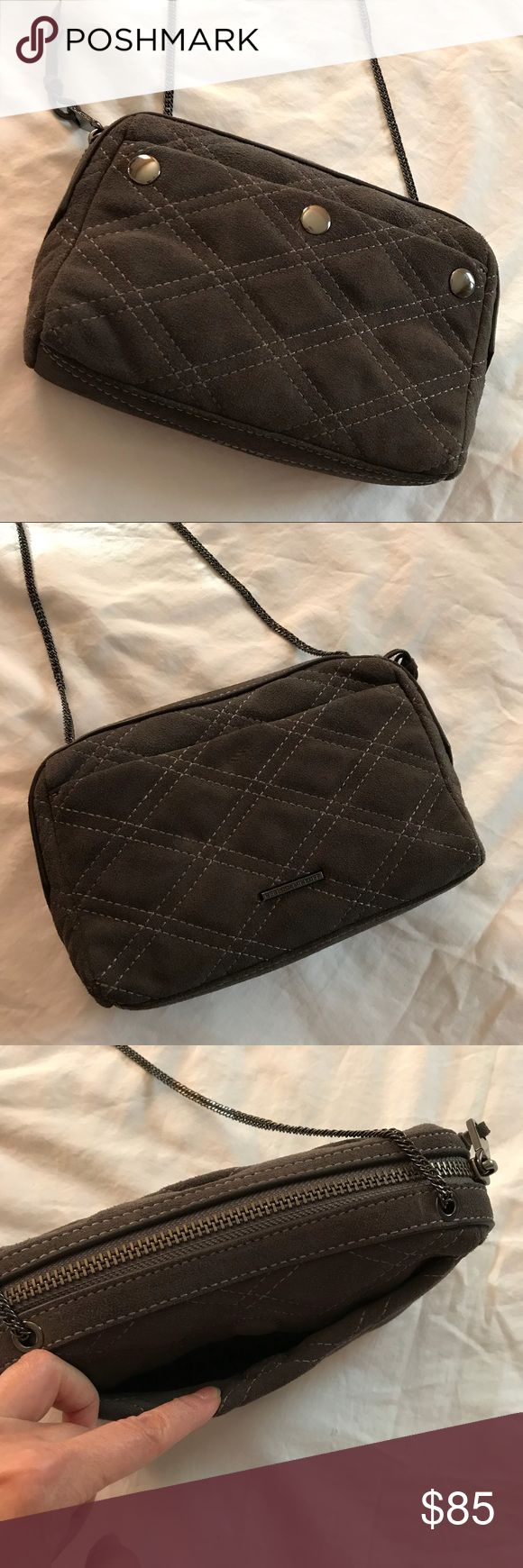 """REBECCA MINKOFF Grey Quilted Suede Crossover Bag Brand new no tags, very cute Rebecca Minkoff Crossover Bag in a grey quilted suede leather with a thin metal chain. Chain strap is in a dark grey metal color with a 22"""" drop. Comes with extra leather replacement tassels for the zipper pull. Rebecca Minkoff Bags Crossbody Bags"""
