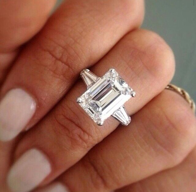 Emerald cut diamonds and tapered baguette diamonds look so perfect together. And that center stone is at least 3 carats!