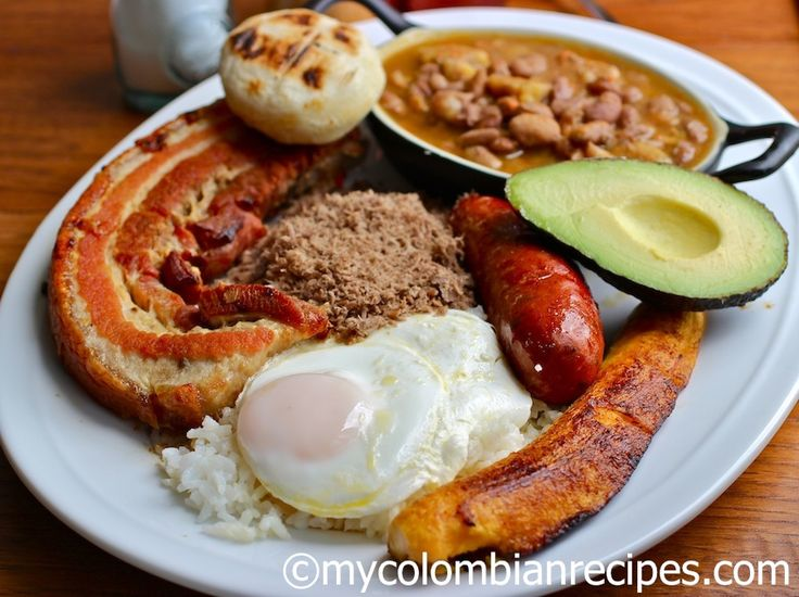 Bandeja Paisa - Tradionally, Bandeja paisa includes beans, white rice, chicharrón, carne en polvo, chorizo, fried egg, ripe plantain, avocado and arepa, but you can substitute the powdered beef for grilled beef or pork.