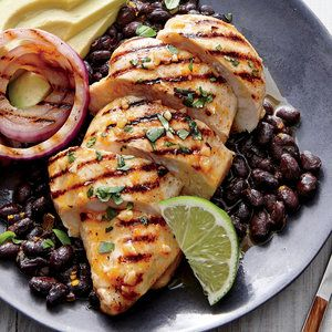 The red onions develop a nice char on the grill, but they finish cooking and develop a depth and sweetness once left to steam. Drizzle any juices from the onion mixture over the grilled chicken.