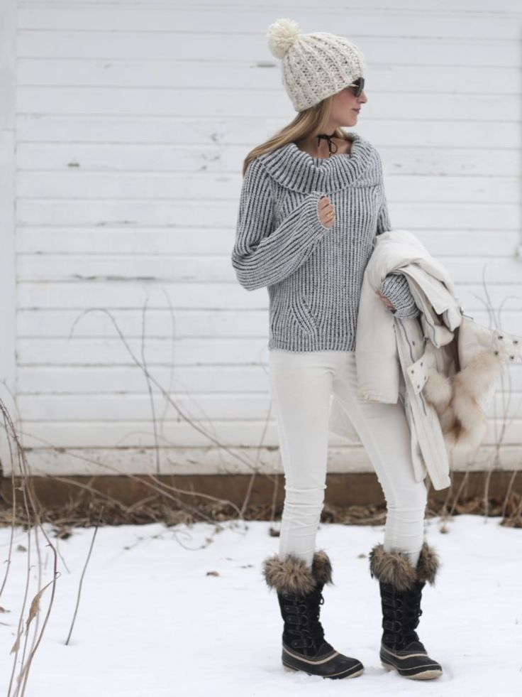 winter snow day outfit with cozy marled knit sweater, skinny white cords, and Sorel snow boots