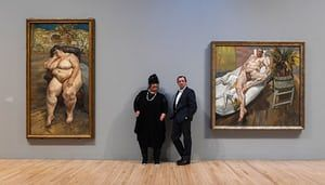 London, UK. Sue Tilley and David Dawson pose in front of paintings of them by Lucian Freud at Tate Britain