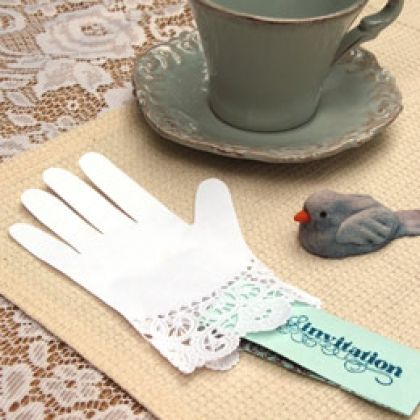 Idea: Cut from paper doilies, these fancy gloves with their lacy trim make fitting invitations for a Cinderella tea party.