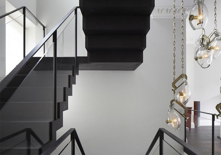 This custom made stairs is the focal point of this home. We joined three apartments to create a luxury mansion in the heart of Kensington and used this stairs to bring all three floors together and bring light deep into the plan.