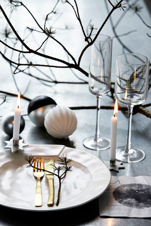 Tabletop Christmas dinner setting baubles twigs candles