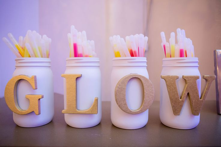 Glow sticks for wedding reception ... decorate containers with sliver glitter and have a cute sign that saying let love glow in a gold frame with a red satin bow glued to it