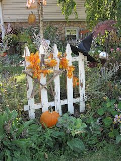primitives by olde lady morgan ~ love the old gate and Halloween decoration ( witch hat, wooden star, leaves and pumpkin)