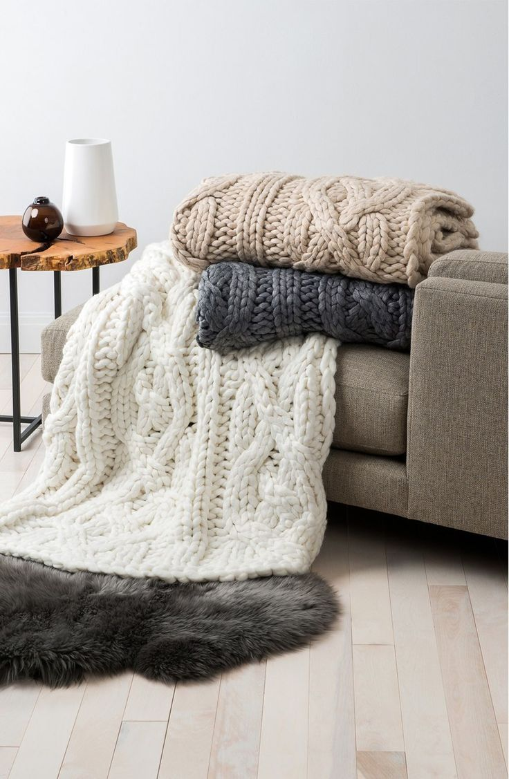 Lounging at home with a good book, tea and this supersoft knit blanket by UGG Australia. It will provide exceptional warmth and cozy style.