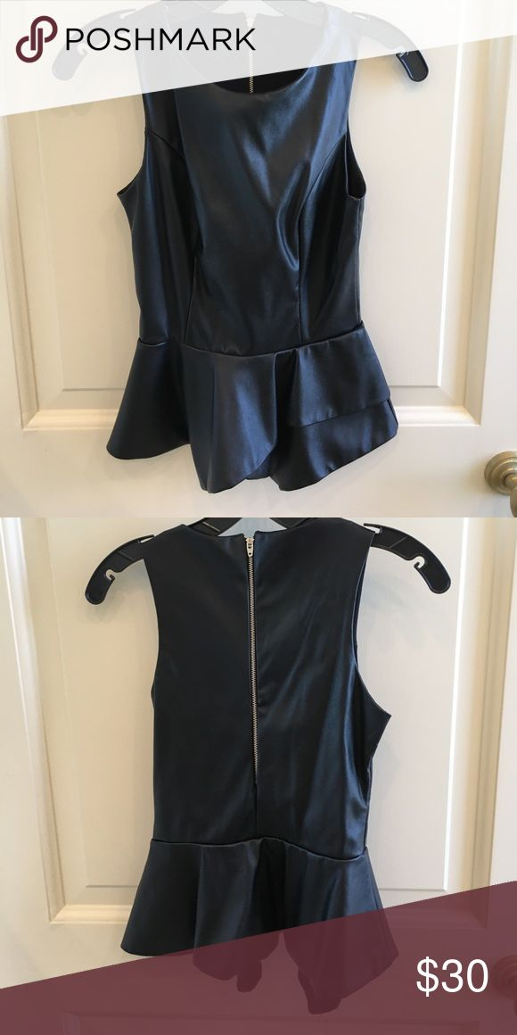 Vegan leather peplum top Black vegan leather peplum top in excellent condition. Only worn once. Pair it with jeans and heels for a sleek, simple look. Tops