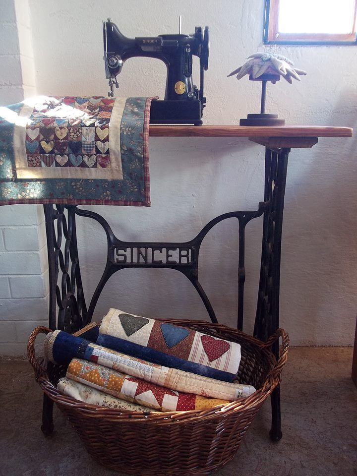 Old sewing tables; pincushions and baskets filled with Quilts;  Tiki Brophy My Quilt Room